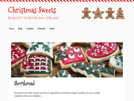 The theme is white and red with Christmas cookie decorations in the header. The font for the site title and headings is a curly, cursive font.