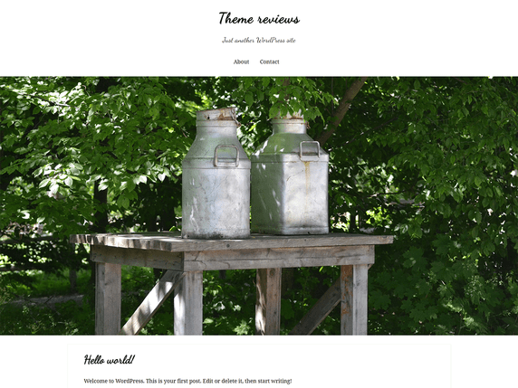 The theme is white and green with a large header image area and a cursive font for the site title and heading.